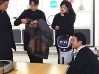旺宝亮相引关注 科沃斯推机器人导购店